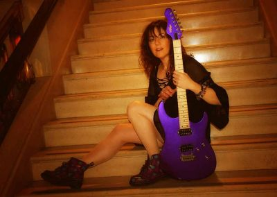 carrie-martin-electric-guitar-on-stairs