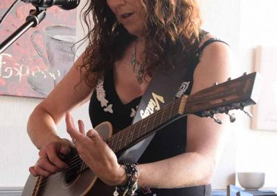 carrie-martin-playing-acoustic-guitar