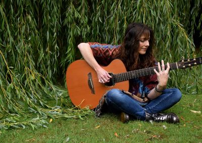 carrie-martin-plays-guitar-under-willow-tree